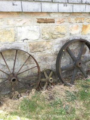 Two metal wheels and metal pulley