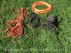 Three extension cords and air hose