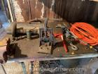 4 inch bench vice, extension cord, binder, etc. Content on table