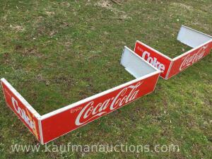 Two metal Coca-Cola signs