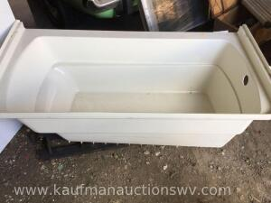 Hard plastic bathtub