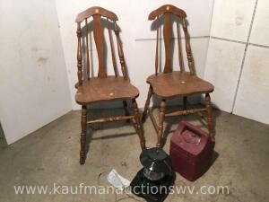 Two wooden chairs and Coleman lantern