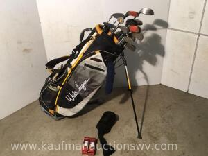 Walter Hagan golf bag with assorted golf clubs and balls