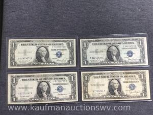 Four 1935 blue seal $1 silver certificates