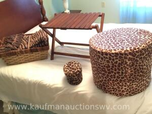 Leopard print pedestal, basket, towels, folding table