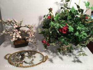 Artificial floral arrangements and mirrored dresser platter
