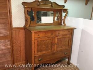Antique oak clawfoot on Wood casters sideboard