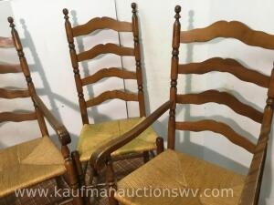 Four ladder back woven bottom chairs