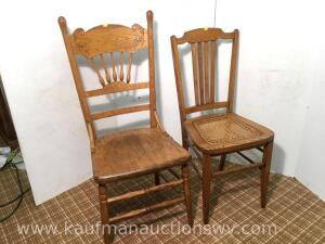 Two oak dining room table chairs