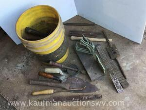 5 gallon bucket with assortment of tools