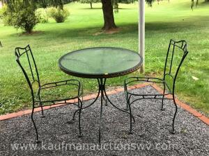 Round metal patio table and two chairs