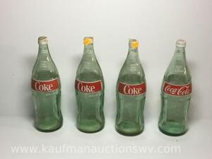 4-32 ounce glass Coke bottles