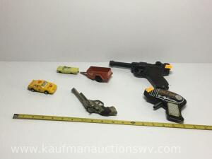Cap guns, atomic space gun and toy cars