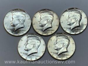 Five 1964 uncirculated Kennedy halves
