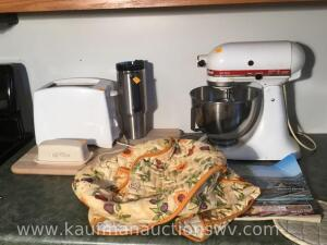 KitchenAid mixer, toaster, butter dish, Stanley thermos, warmer, cutting board