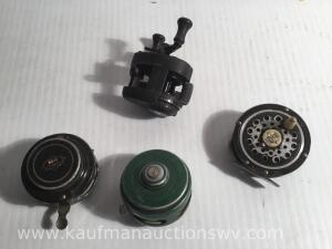 Three fly fishing reels and other reel