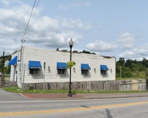 Income Producing Commercial Lot with Building