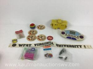 Family feud game, old German beer coasters, plastic train car, happy meal toys, Heinz pickle pins and the more