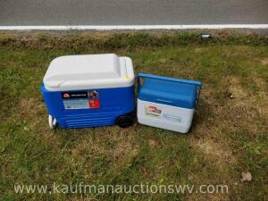Two coolers, largest one is on wheels and has handle