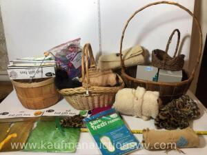 Three baskets with foil gift boxes, fabrics