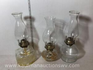 Three lamplight Farms kerosene lamps