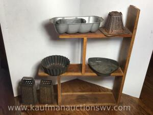 Wooden shelf and baking pans and graders