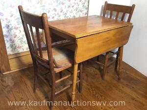 Drop leaf kitchen table and two chairs