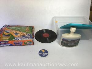 Waterslide, records, West Virginia gator bowl pin, WVU Decanter