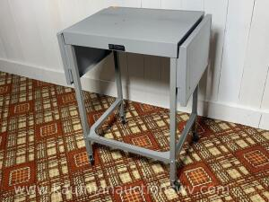 Metal dropleaf table on casters