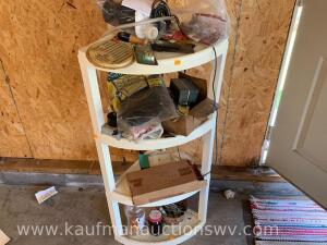 4 tier corner shelf with contents
