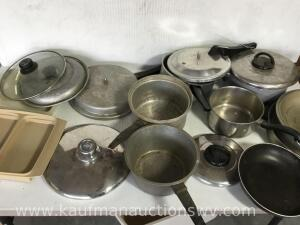 Collection of pot and pans some lids
