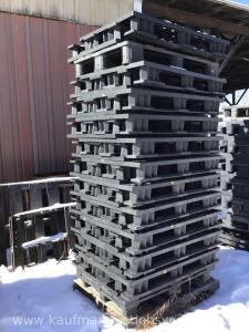 Approximately 25 plastic pallets