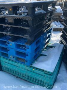 Approximately 20 plastic pallets